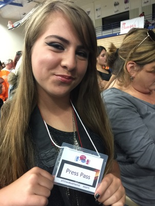 Isabel gets her official press pass.